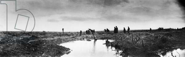 WWI: PASSCHENDAELE, 1917 Canadian soldiers and German prisoners crossing a muddy battlefield after the Battle of Passchendaele in Belgium. Photograph by William Rider-Rider, 1917.
