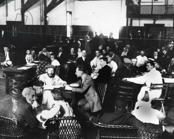 ELLIS ISLAND, 1923 Immigrants in the dining hall at Ellis Island. Photograph, 1923.