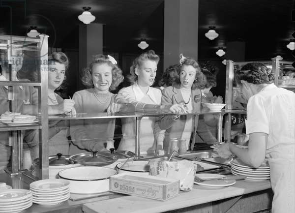 HIGH SCHOOL STUDENTS, 1943 Students in the cafeteria at Woodrow Wilson High School in Washington, D.C. Photograph by Esther Bubley, 1943.