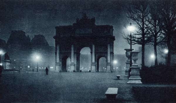 FRANCE: PARIS, c.1920 The Arc de Triomphe du Carrousel at night. Photograph, c.1920.