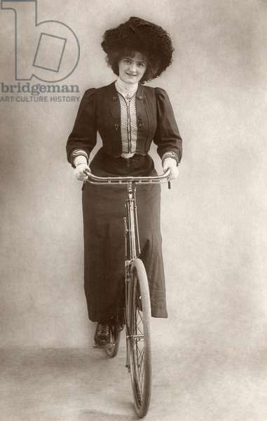 ENGLISHWOMAN ON BICYCLE Photograph, c.1915.