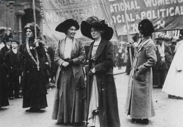 CHRISTABEL PANKHURST (1880-1958). English woman-suffrage advocate. With Mrs. Emmeline Pethick-Lawrence at a suffragette demonstration by the Women's Social and Political Union, London, 1909.