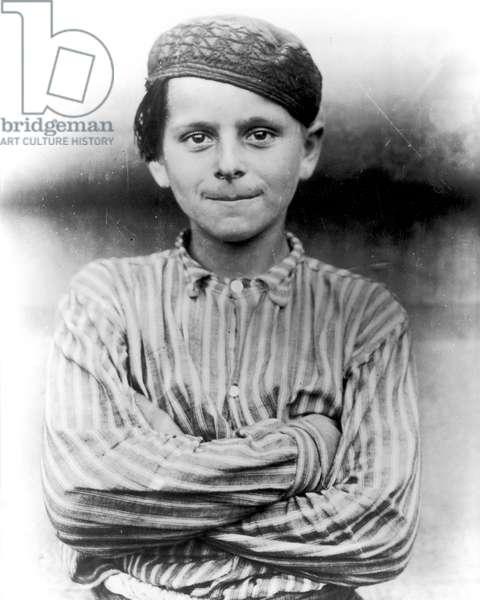 IMMIGRANTS: ELLIS ISLAND An immigrant boy at Ellis Island, c.1900.