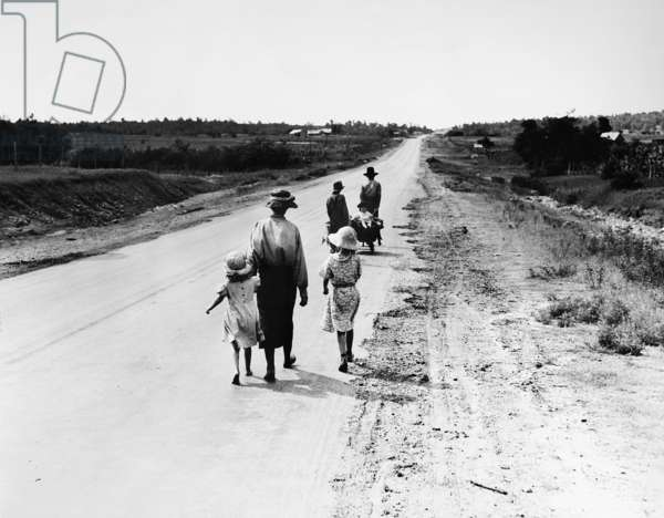 Homeless family, tenant farmers in 1936. Cut from the land by illness, driven to the road by poverty, they walk from county to county in search of the meager security of relief. P.S.T, Oklahoma, June 1938 (b/w photo)