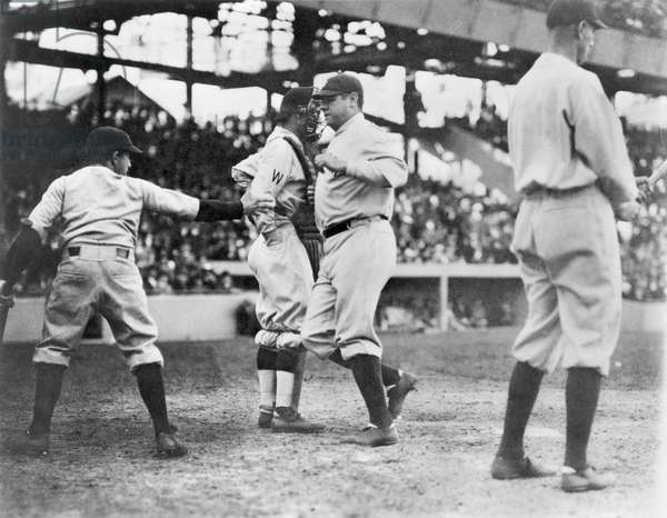 BABE RUTH (1895-1948) American professional baseball player. Ruth arriving at home plate after hitting a home run in Washington, D.C., on April 21, 1924.