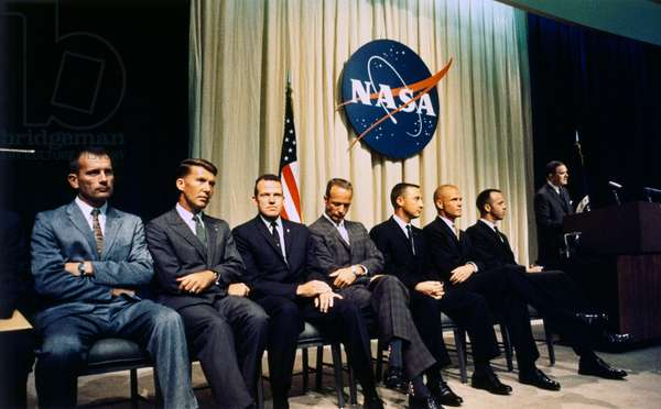 MERCURY SEVEN, c.1964 The astronauts known as the Mercury Seven or Original Seven. Left to right: Deke Slayton, Wally Schirra, Donald Cooper, Scott Carpenter, Gus Grisson, John Glenn, Alan Shepard and NASA administrator James E. Webb. Photograph, c.1964.