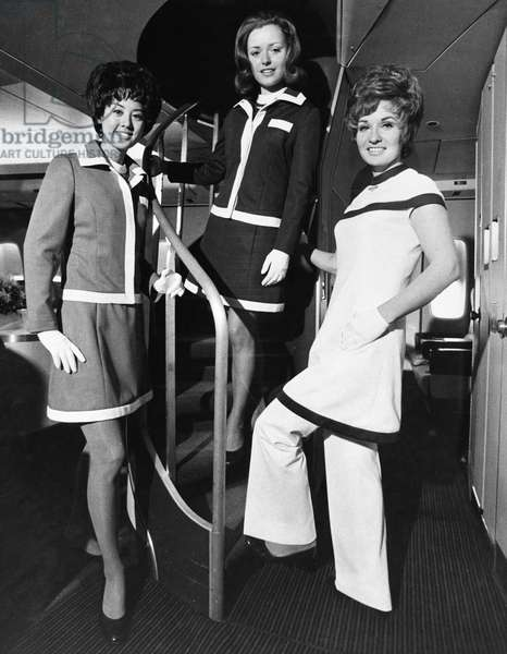 FLIGHT ATTENDANTS American Airlines flight attendants on board a Boeing 747 airplane. Photograph, c.1972.