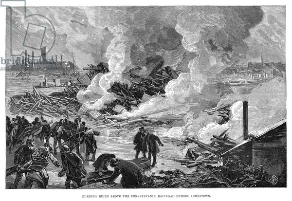 JOHNSTOWN FLOOD, 1889 'Burning ruins above the Pennsylvania Railroad Bridge, Johnstown.' Engraving, 1889.