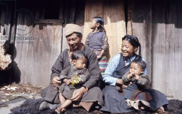 INDIA: FAMILY, 1971 The Jorbu family seated outside their home in Lachung, Sikkim, India. Photograph by Alice Kandell, 1971.