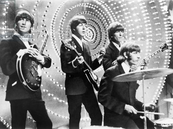 THE BEATLES, c.1964 The Beatles in concert. Photograph, c.1964.