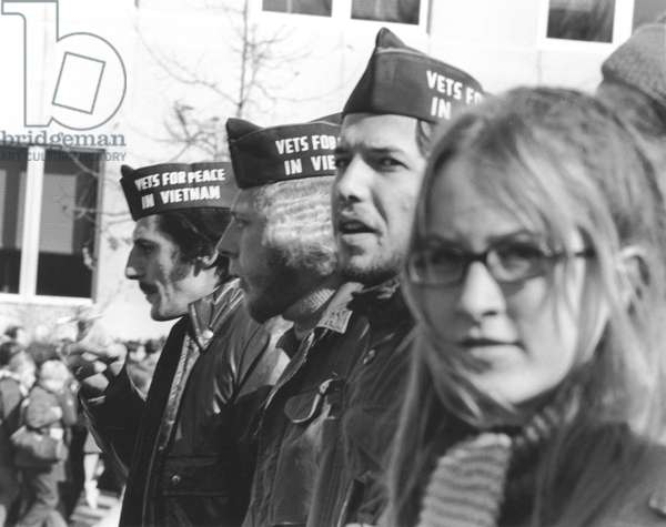 ANTI-WAR PROTEST, 1969 Vietnam War veterans, wearing 'Vets for Peace in Vietnam' hats, march in a parade in Washington, D.C., on 15 November 1969, to protest the war along with some 600,000 other demonstrators.