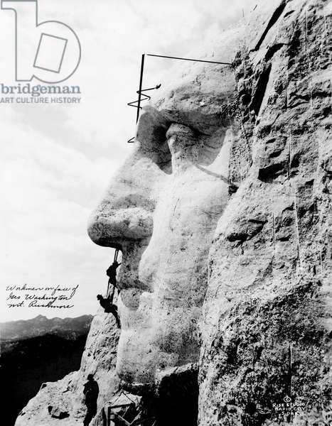 MOUNT RUSHMORE, c.1932 Workmen sculpting the face of George Washington at Mount Rushmore, South Dakota. Photograph, c.1932.