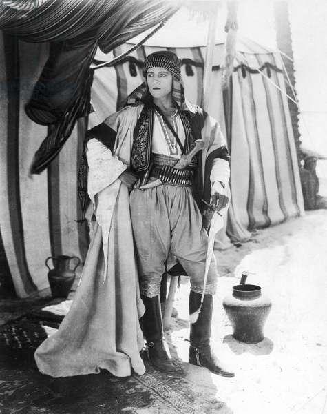 RUDOLPH VALENTINO (1895-1926). American (Italian-born) film actor. In a scene from the film 'The Sheik,' 1921.