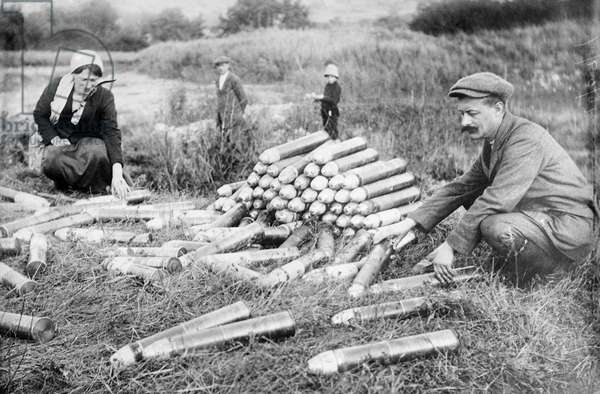WWI: AMMUNITION, 1914 Civilians looking at artillery shells abandoned by the German military at the Battle of the Marne near Paris, France. Photograph, 29 October 1914.