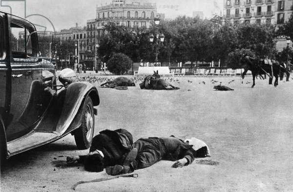 SPANISH CIVIL WAR, c.1938 Casualties in the Plaça Catalunya, Barcelona after a battle of the Spanish Civil War. Photograph, c.1938.