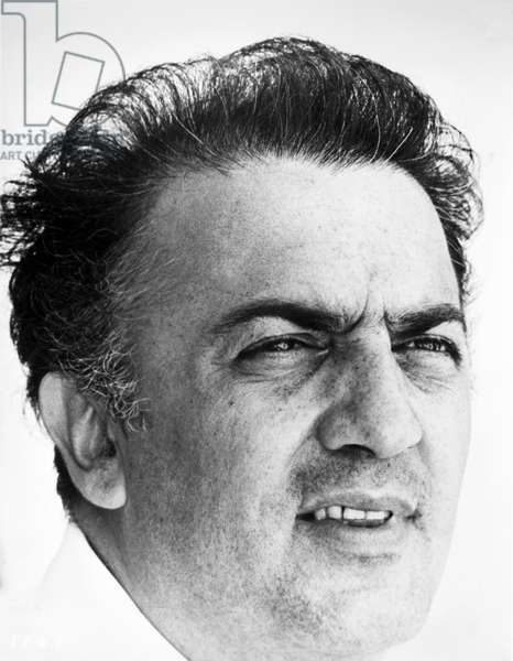FEDERICO FELLINI (1920-1993) Italian film director. Photographed in 1963.