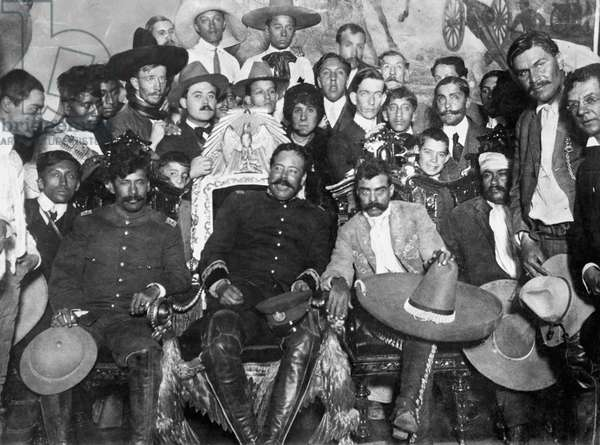 FRANCISCO 'PANCHO' VILLA (1878-1923). Mexican revolutionary leader. Villa (center) and Emiliano Zapata (next to Villa, right, with sombrero on knee) in the Presidential Palace at Mexico City. Seated next to them are revolutionary generals Tomás Urbina (left) and Otilio Montaño (right, head bandaged). Photograph, 1914, by Agustin Casasola.