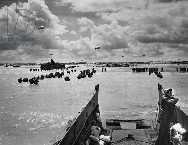 WORLD WAR II: NORMANDY Reinforcements and supplies arrive at the beach of Normandy after the German army was driven back into the interior during the D-Day invasion, June 1944.