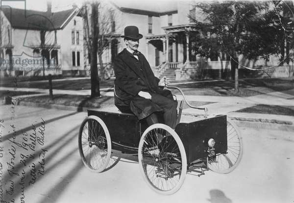 HENRY FORD (1853-1947) American automobile manufacturer. Photographed with his first automobile in 1896.