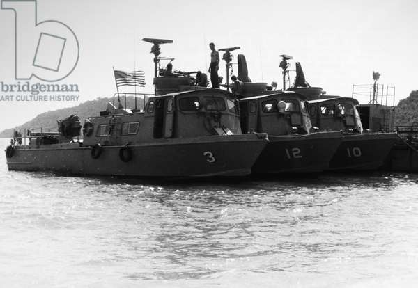 VIETNAM WAR: SWIFT BOATS U.S. Navy Swift boats being prepared for a patrol at An Thoi, South Vietnam, February 1966.