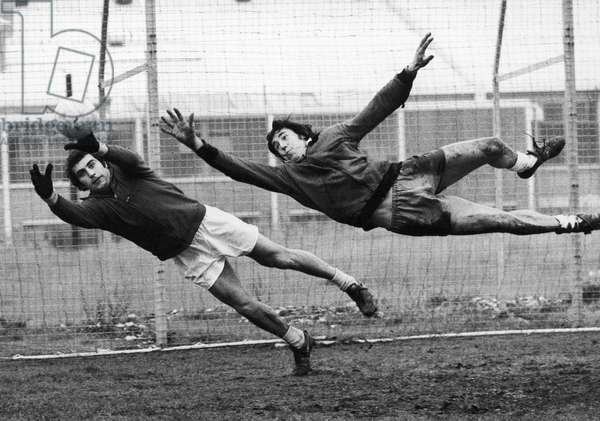 SOCCER GOALIES, 1974 English goalkeeper Peter Shilton (left) and Gordon Banks both jump to block a goal during a work-out at Stoke City, November 1974.