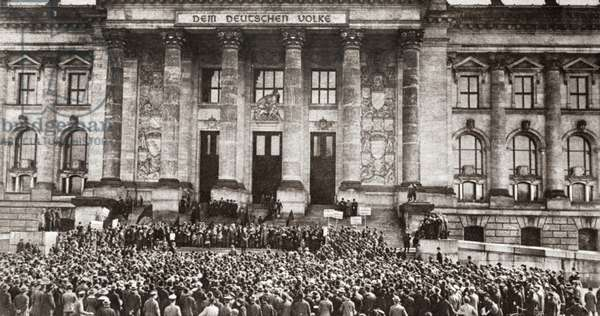 WORLD WAR I: BERLIN, 1919 Crowds assemble to protest the terms of the Treaty of Versailles outside the Reichstag in Berlin, Germany. Photograph, 1919.