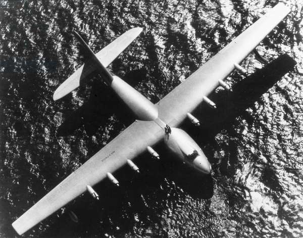 SPRUCE GOOSE, 1947 The millionaire industrialist and aviator Howard Hughes piloting his eight-engine H-4 Hercules, nicknamed the 'Spruce Goose,' the world's largest all-wood seaplane, across Los Angeles Harbor on 2 November 1947.
