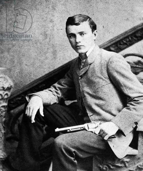 ROBERT FORD ( c.1861-1892) American desperado. Ford posing with the .44 revolver, a gift from Jesse James, with which he would kill the gang leader in 1882 for a ,000 reward.