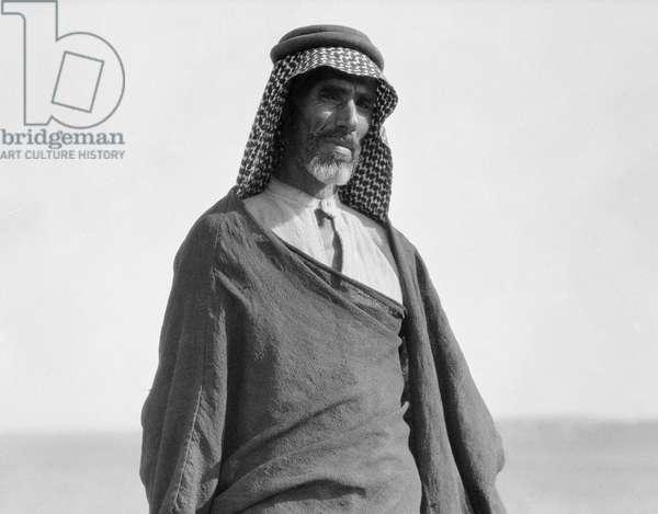 IRAQ: BEDOUIN MAN, c.1932 A Bedouin man near Borsippa, Iraq. Photograph, c.1932.