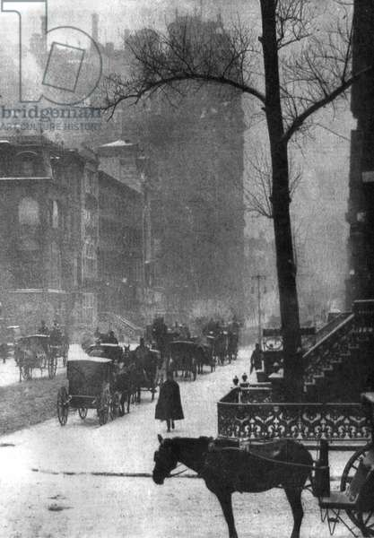 STIEGLITZ: NEW YORK, 1903 Horses and carriages on a snowy street in New York City. Photograph by Alfred Stieglitz, 1903.