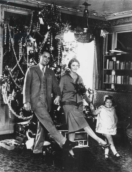 F. SCOTT FITZGERALD FAMILY Francis Scott Key Fitzgerald (1896-1940). American writer. At Christmas-time with his wife Zelda and daughter 'Scottie.'