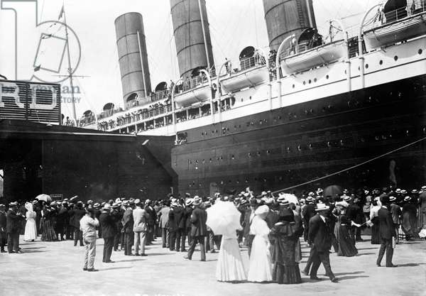 NEW YORK: LUSITANIA, 1907 The Cunard steamship 'Lusitania' at the pier in New York City, 13 September 1907.