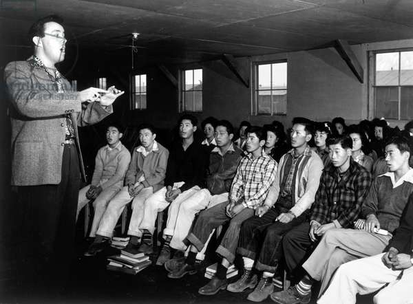 JAPANESE INTERNMENT, 1943 Choir with director Louie Frizzell, at the Manzanar Relocation Center for Japanese-Americans at Owens Valley, California. Photograph by Ansel Adams, 1943.
