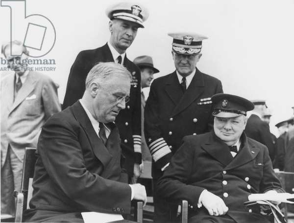 FRANKLIN DELANO ROOSEVELT (1882-1945). 32nd President of the United States. Aboard HMS 'Prince of Wales' in August 1941 with Winston Churchill and (rear, from left) Harry Hopkins, Commander of the Atlantic Fleet Adm. E.J. King, and Chief of U.S. Naval Operations Adm. Harold Stark. This meeting established the Atlantic Charter.