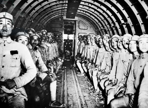 CHINESE SOLDIERS, c.1940 Chinese soldiers on troop transport aircraft. Photographed c.1940.