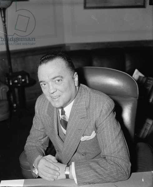 JOHN EDGAR HOOVER (1895-1972). American lawyer and public official. Photographed in his office as Director of the F.B.I., 5 April 1940.