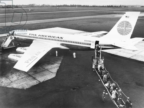 BOEING 707 PLANE, 1958 Passengers disembarking from a Boeing 707-121 jet clipper operated by Pan American Ailines. Photograph, 1958.