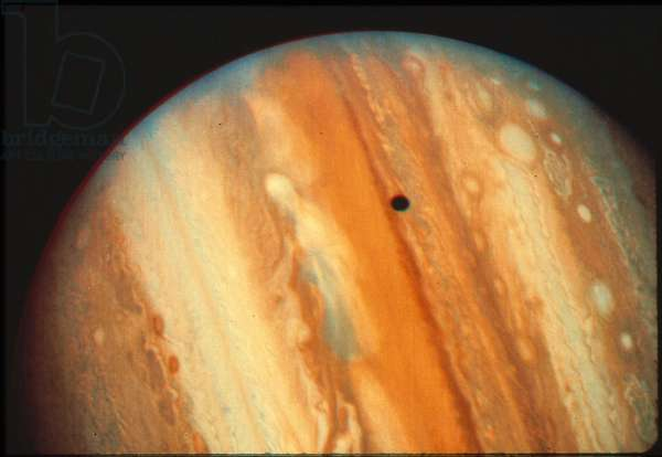 JUPITER Voyager photograph of Jupiter cloud structure and shadow of Io.