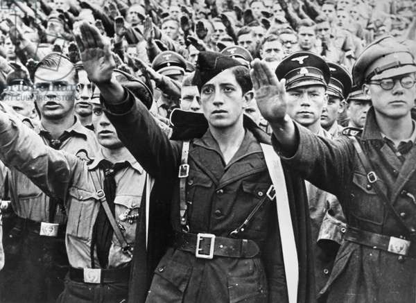 HITLER YOUTH, c.1940 Young men of the Hitler Youth saluting. Photograph, c.1940.