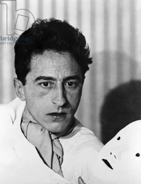 JEAN COCTEAU (1889-1963) French writer and artist. Photographed by Berenice Abbott, 1928.