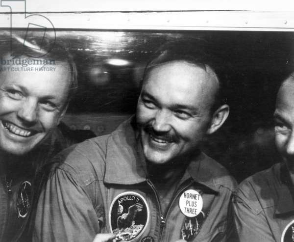 SPACE: APOLLO 11, 1969 Astronauts Neil Armstrong, Michael Collins, and Edwin 'Buzz' Aldrin in the quarantine following the Apollo 11 mission. Photograph, 1969.