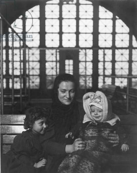HINE: ELLIS ISLAND An Italian mother with her children at Ellis Island. Photograph by Lewis W. Hine, 1905.