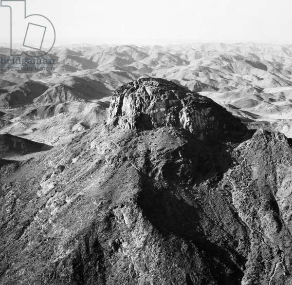 SAUDI ARABIA: MOUNT HIRA. Muhammad received the first revelations from God through the angel Gabriel in a cave on Mount Hira. Photograph, 1970s.