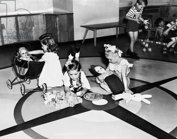 ELLIS ISLAND: CHILDREN, 1951 Children of detained immigrants, playing with toys in a playroom at Ellis Island, New York City. Photograph, 1951.
