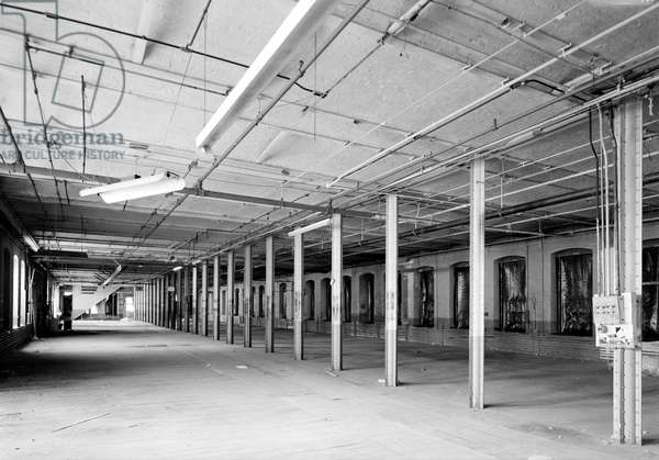 COLT FACTORY, 2005 Colt Firearms Company, fourth floor of the east armory building showing line of phoenix columns, Hartford, Connecticut. Photograph by Jet Lowe, 2005.