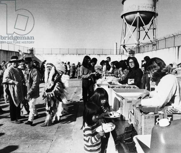 ALCATRAZ OCCUPATION, 1969 Native American activists having a buffet-style Thanksgiving Day feast during their occupation of the former federal prison on Alcatraz Island in San Francisco Bay, California, 27 November 1969.