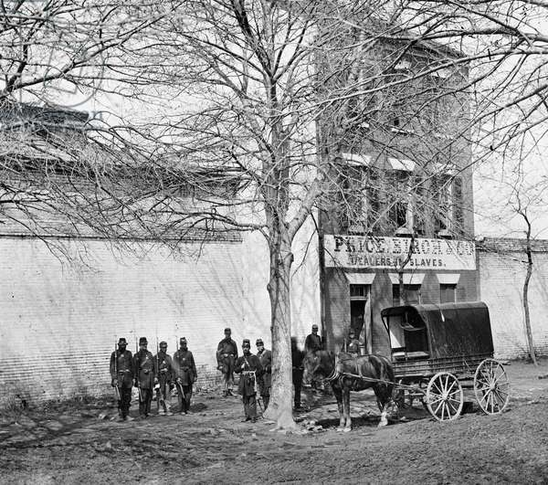 VIRGINIA: SLAVE DEALER Union Army guards in front of a slave-dealing establishment of Price, Birch, and Co. in Alexandria, Virginia. Photographed c.1861.