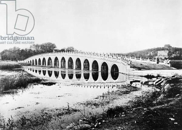 CHINA: MARBLE BRIDGE A view of the marble bridge on the grounds of Yuan Ming Yuan, or the Old Summer Palace, near Peking, China. Photographed by John Thomson, c.1870.