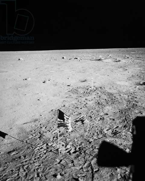 APOLLO 11 LANDING, 1969 The American flag on the surface of the moon, photographed from inside the lunar module during the Apollo 11 mission, 1969.