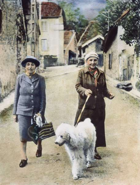 STEIN AND TOKLAS, 1944 American writer Gertrude Stein (1874-1946) in southeastern France with her companion, Alice B. Toklas (left), September 1944. Oil over a photograph.